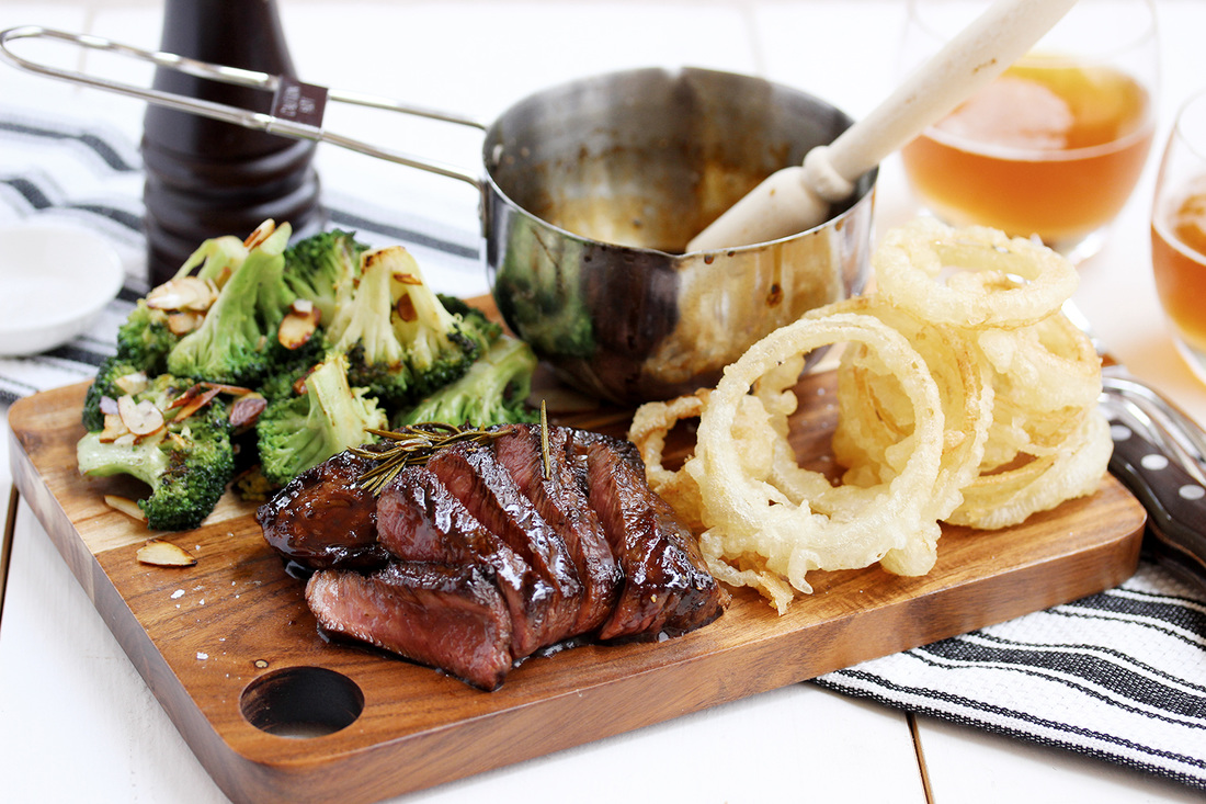 Whiskey glazed steak with onion rings